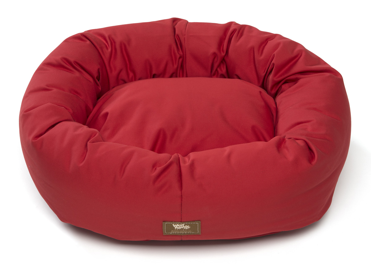 Abby's dog bed that has been taken over by cats   Super comfy, and has lasted 5 years. Totally machine washable (a must for me) and lightweight enough to travel with. lots of colors to chose from. a little spendy.
