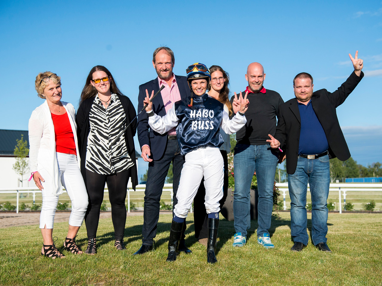 Swedish rider Fanny Olsson and representatives from Håbo Buss, her sponsor in the Lady Jockeys' Thoroughbred World Championship.