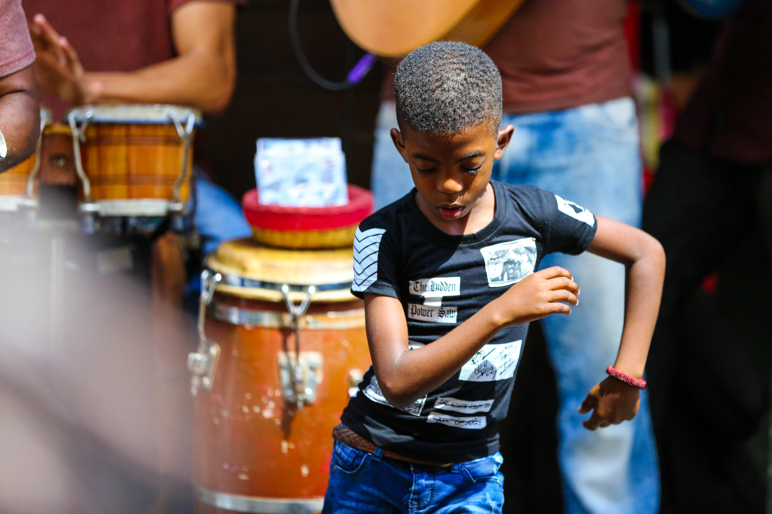 A young boy  dances rumba while a band plays on the street. March 2, 2019, in Old Havana, Cuba. ( The GroundTruth Project )
