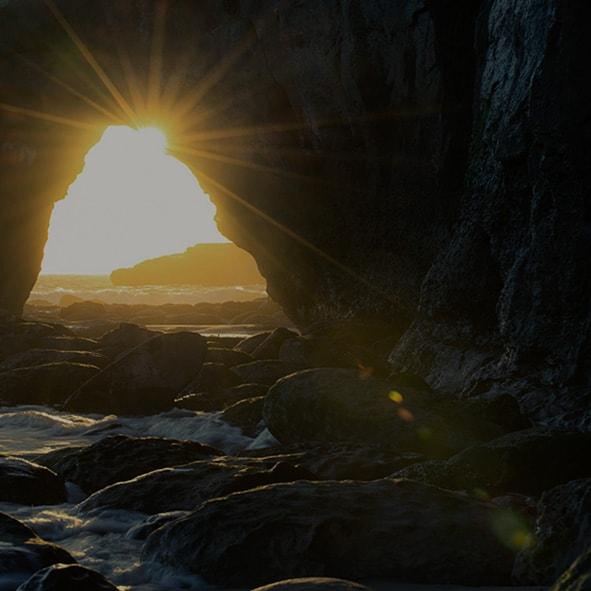 backlit-beach-cave-931910-min.jpg