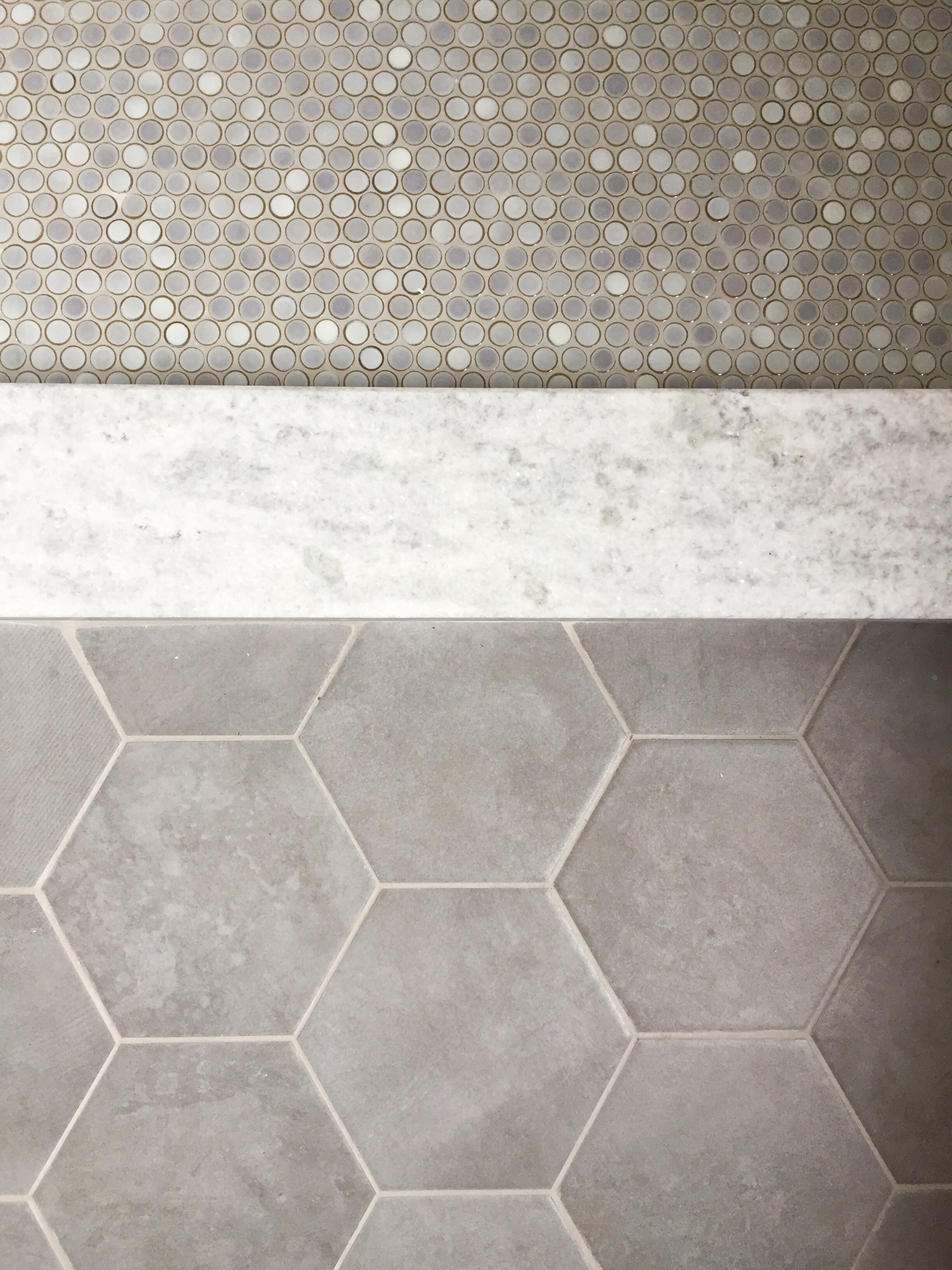 penny tile and hex flooring