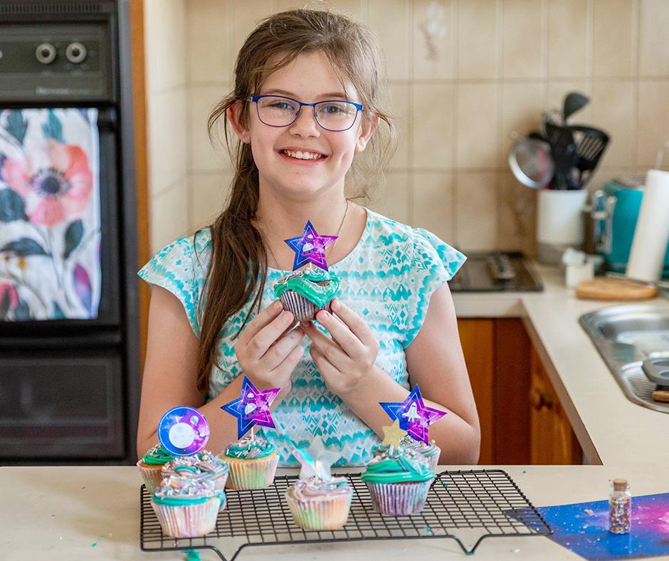 Abbey holding a cupcake.jpg
