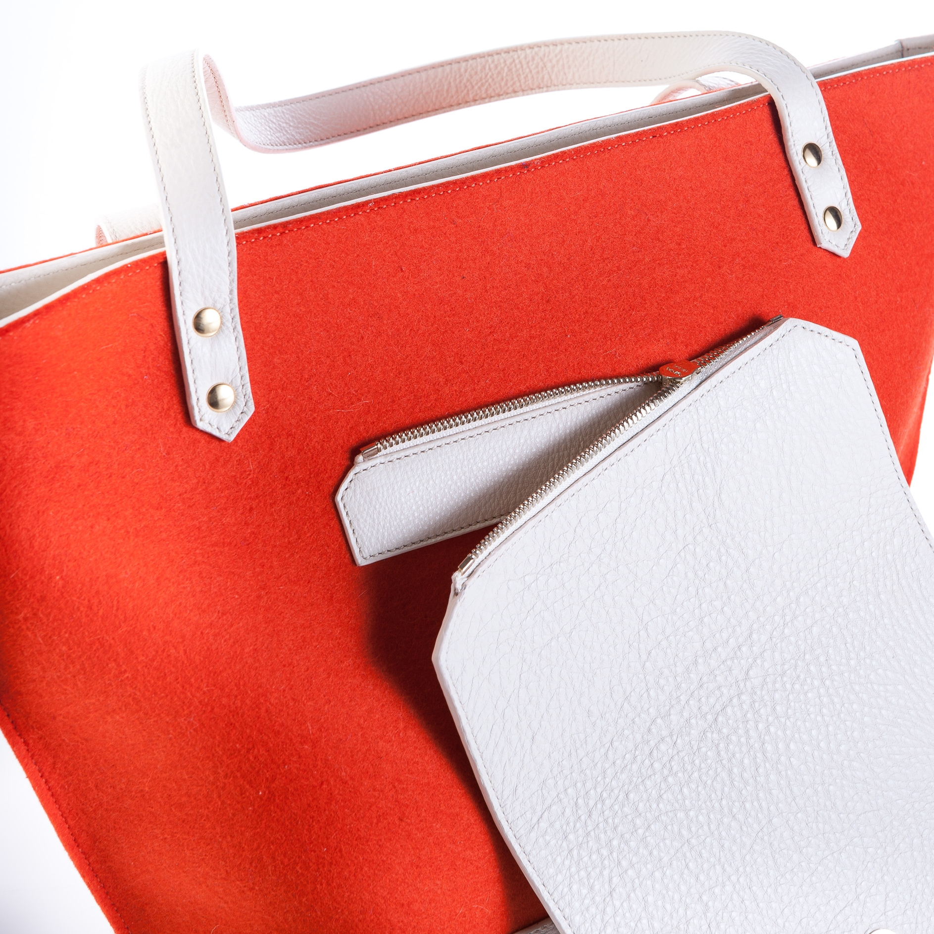 Concept - TTWINN handbags feature a concept of interchangeable flaps giving modern women flexibility in choosing their style by mixing and matching the flaps across the entire TTWINN collection. Every flap is standardized in size and is attached to a bag by zipper making it effortless to change the flaps. By offering various types and styles of flaps we aim to give our customers freedom to express themselves and create their perfect style.