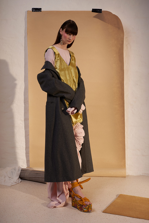 Pink dress by Lisa van Wersch, velvet dress by ACBY, coat by Saint Laurent, shoes stylist's own, earring by Mango