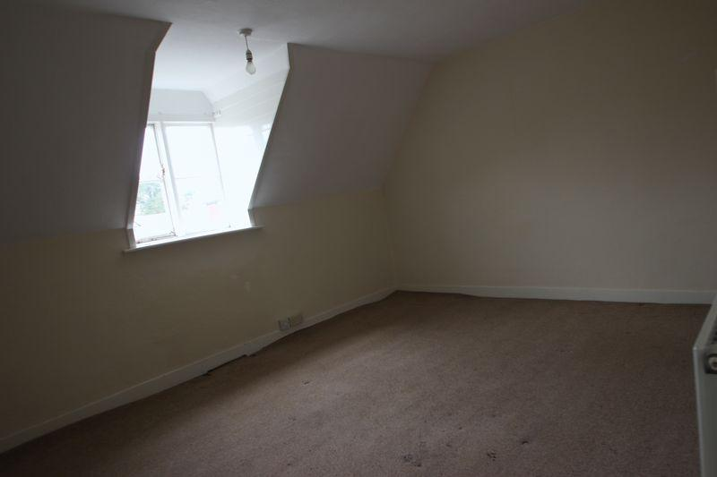 An empty, shabby Bedroom 1
