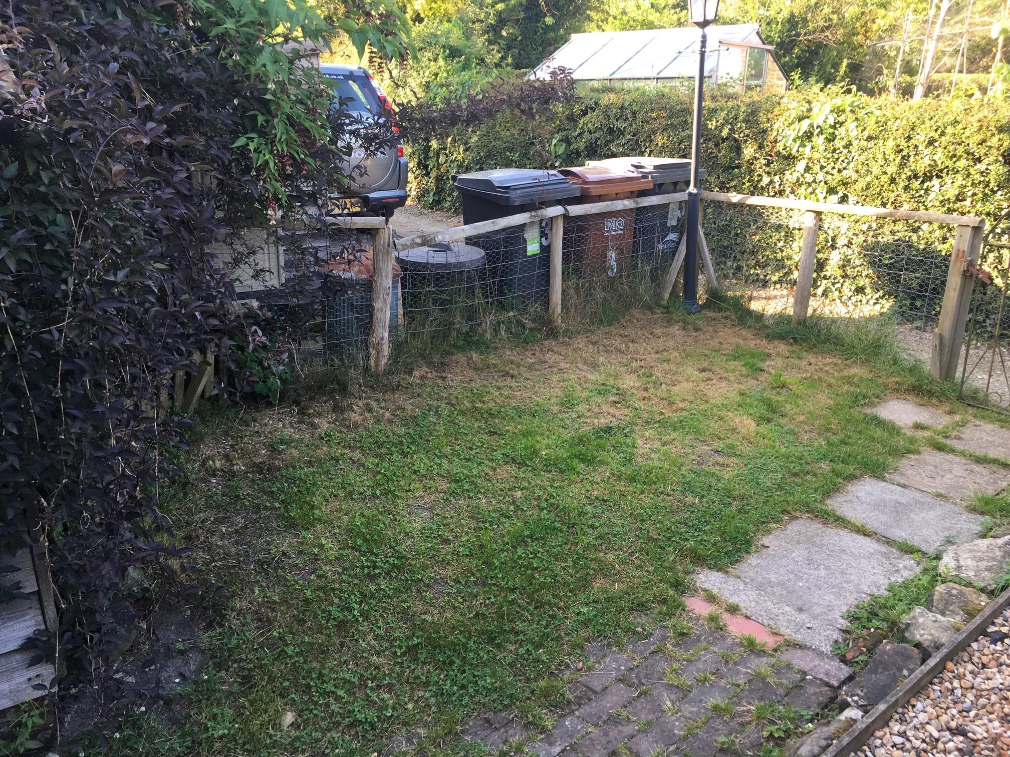 Grassy mound with bins!