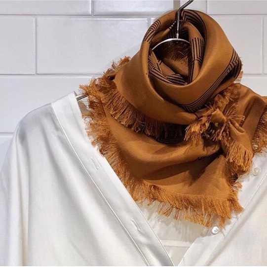 Our Geometric mirage silk scarf in Terracotta hand fringed in Como, Italy | styled by @ikumi__sasaki | #aeneisparis #silkscarf #handcrafted #ethicalfashion #styleinspo