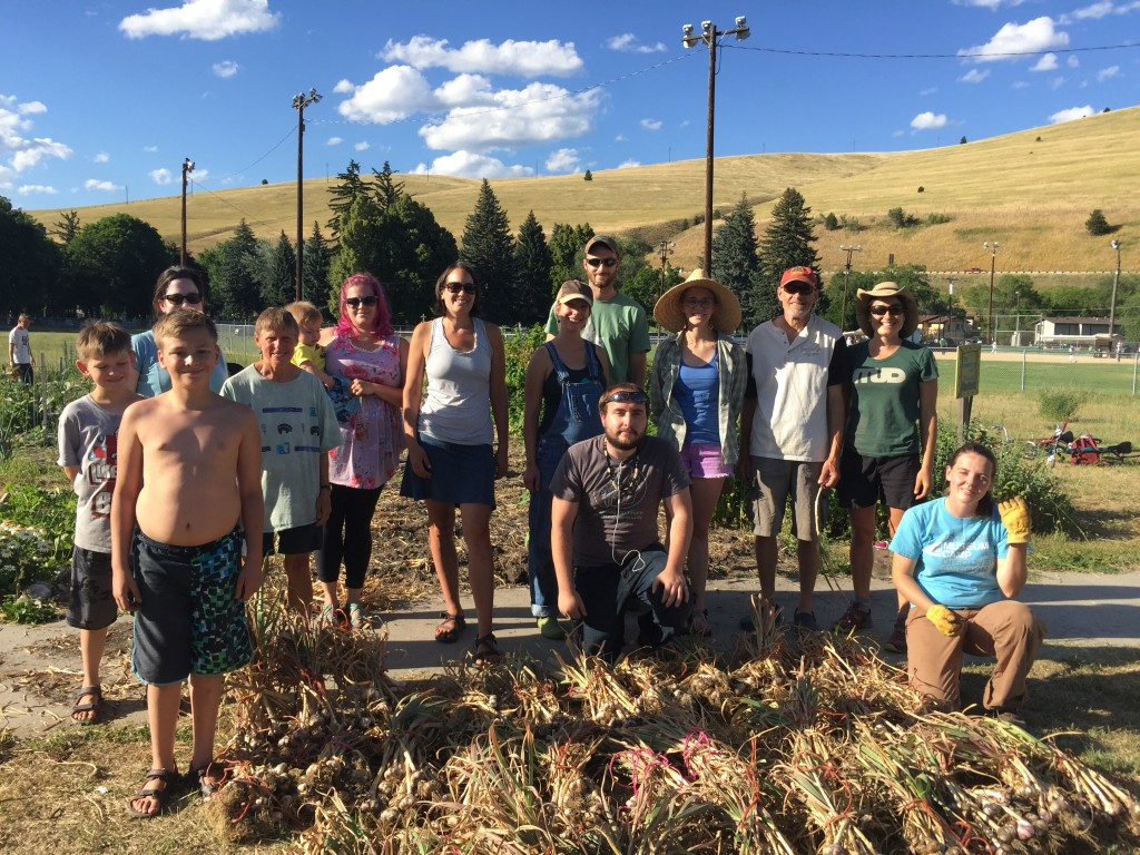 Happy garlic harvesters with more than enough garlic to share!