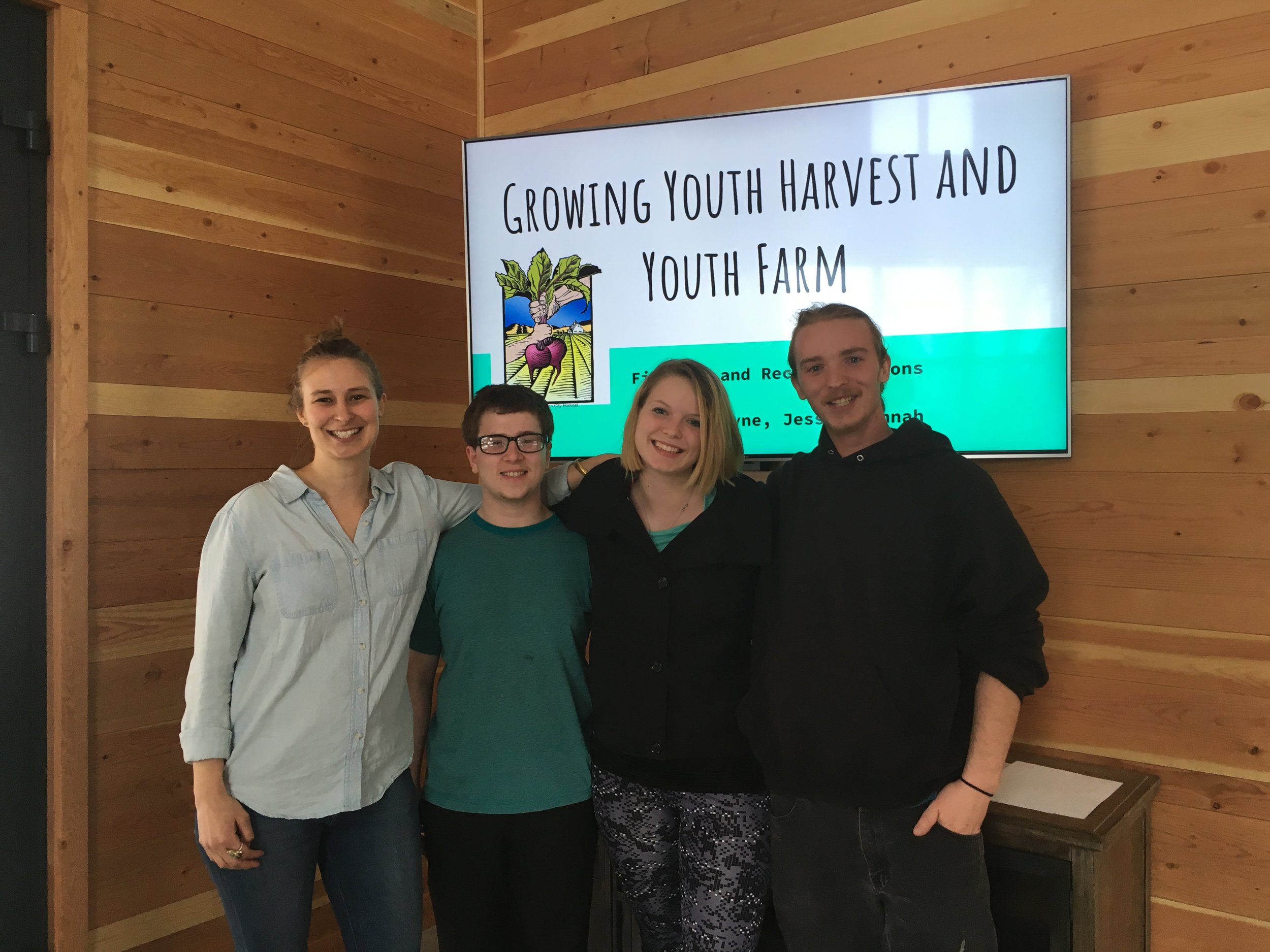 At their presentation to Garden City Harvest staff members, Hannah Oblock, Environmental Studies graduate student and three of the Youth Development alumni.