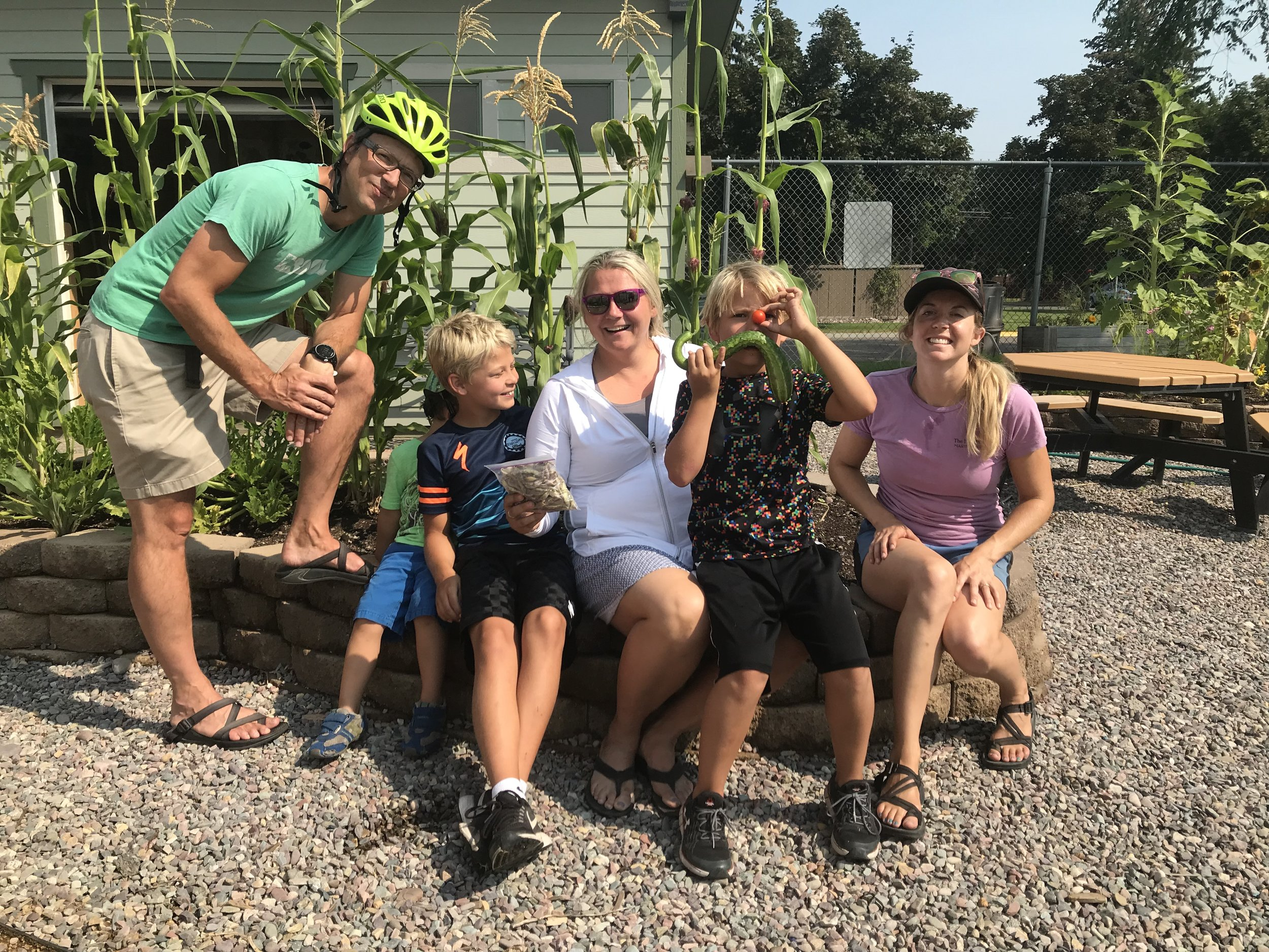 Lori with the Leeds-Knight family last season with some delicious veggies grown in the school garden.