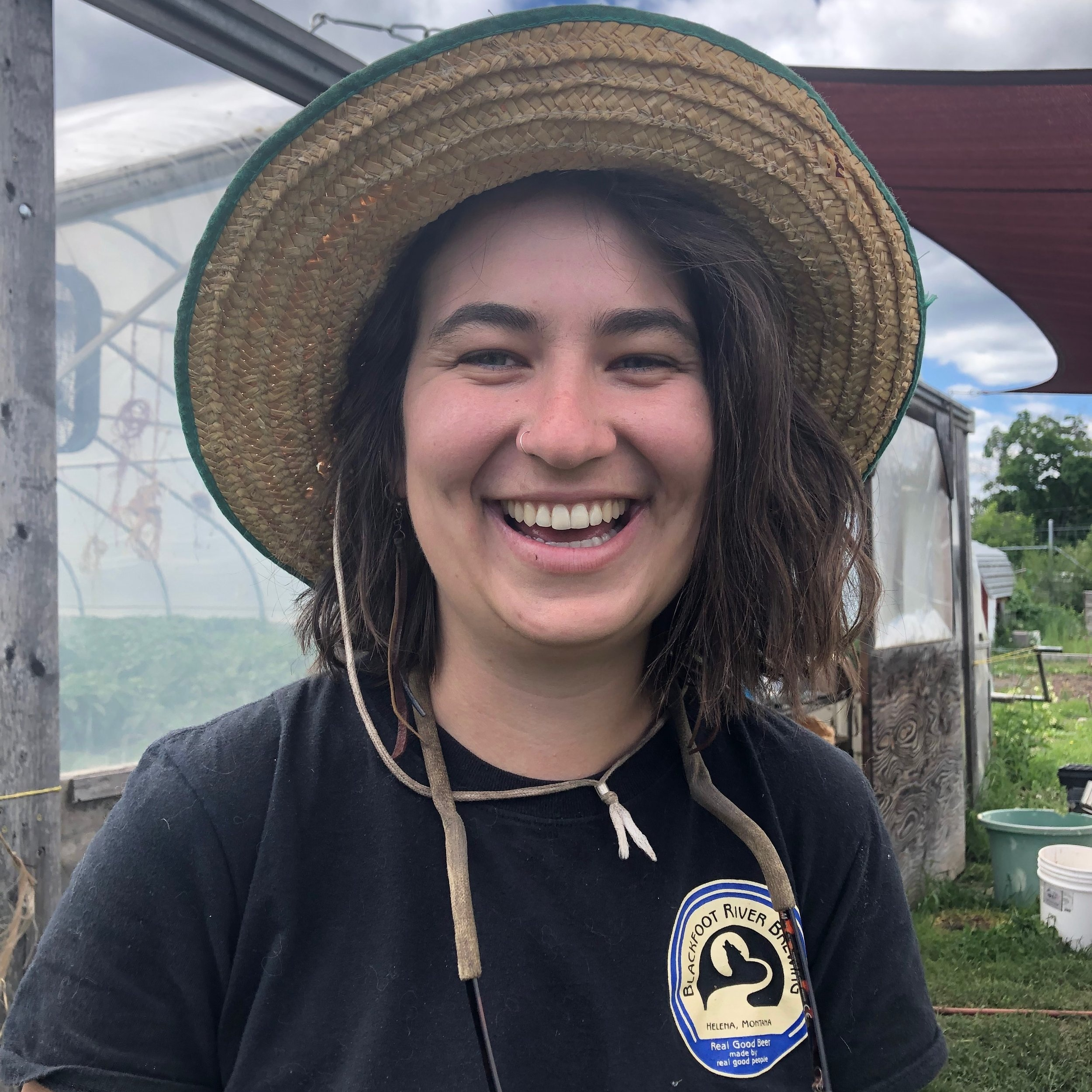 Clare Vergobbi, Orchard Gardens Manager, outside of the Orchard Gardens greenhouse (where almost all of the veggies at 3 of our 4 farms are born).