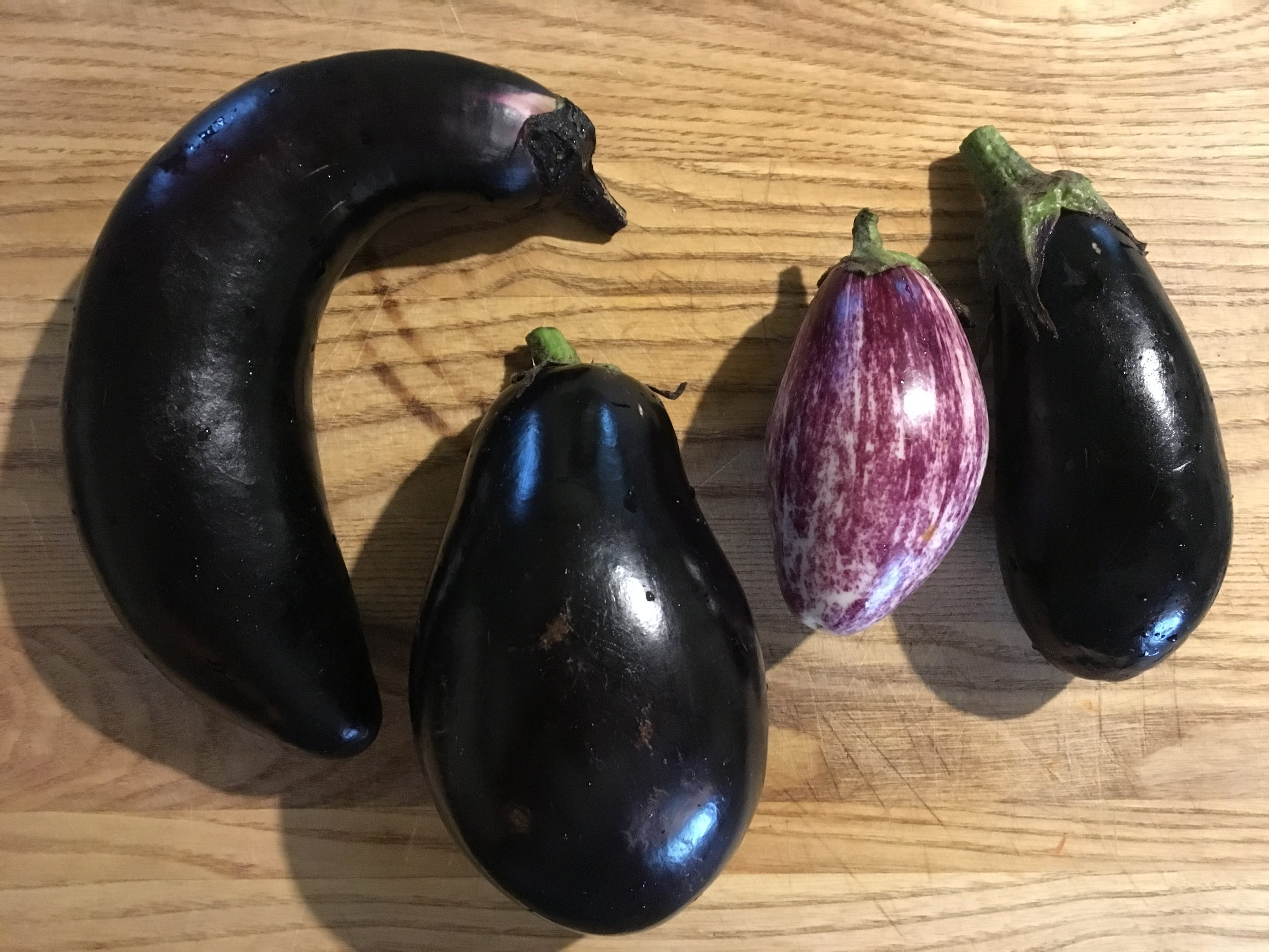 We grow several types of eggplant, and here are the ones I used (from left to right): galine, calliope, diamond (all Asian varieties) and a traditional bell  eggplant.