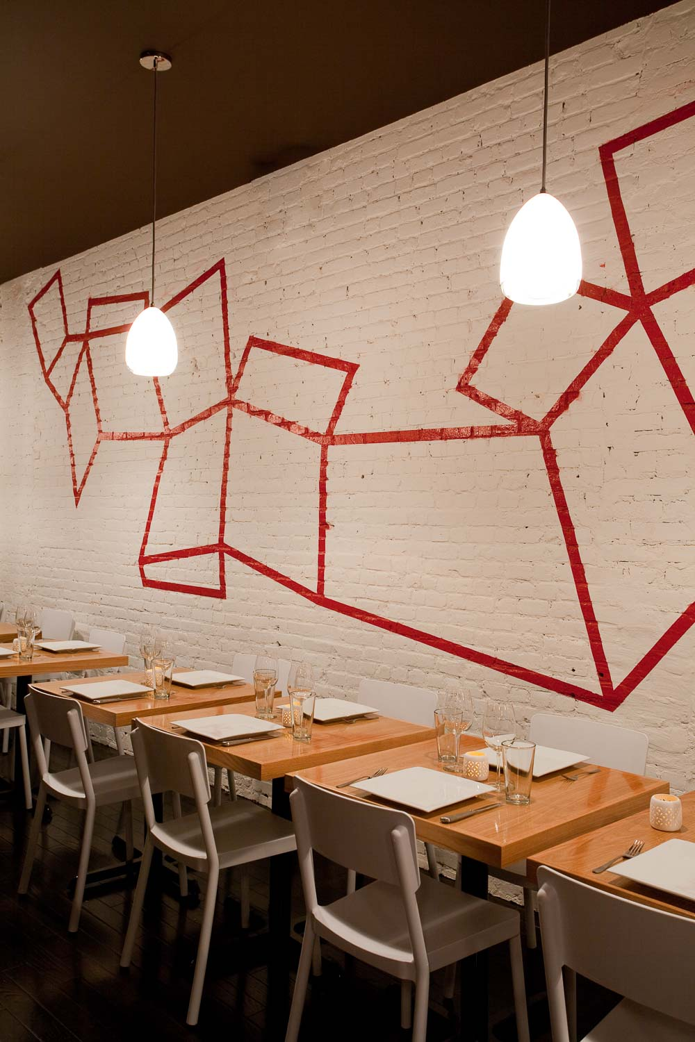 An Interior View of the Tables and the Graffiti Wall by Sergio Mannino