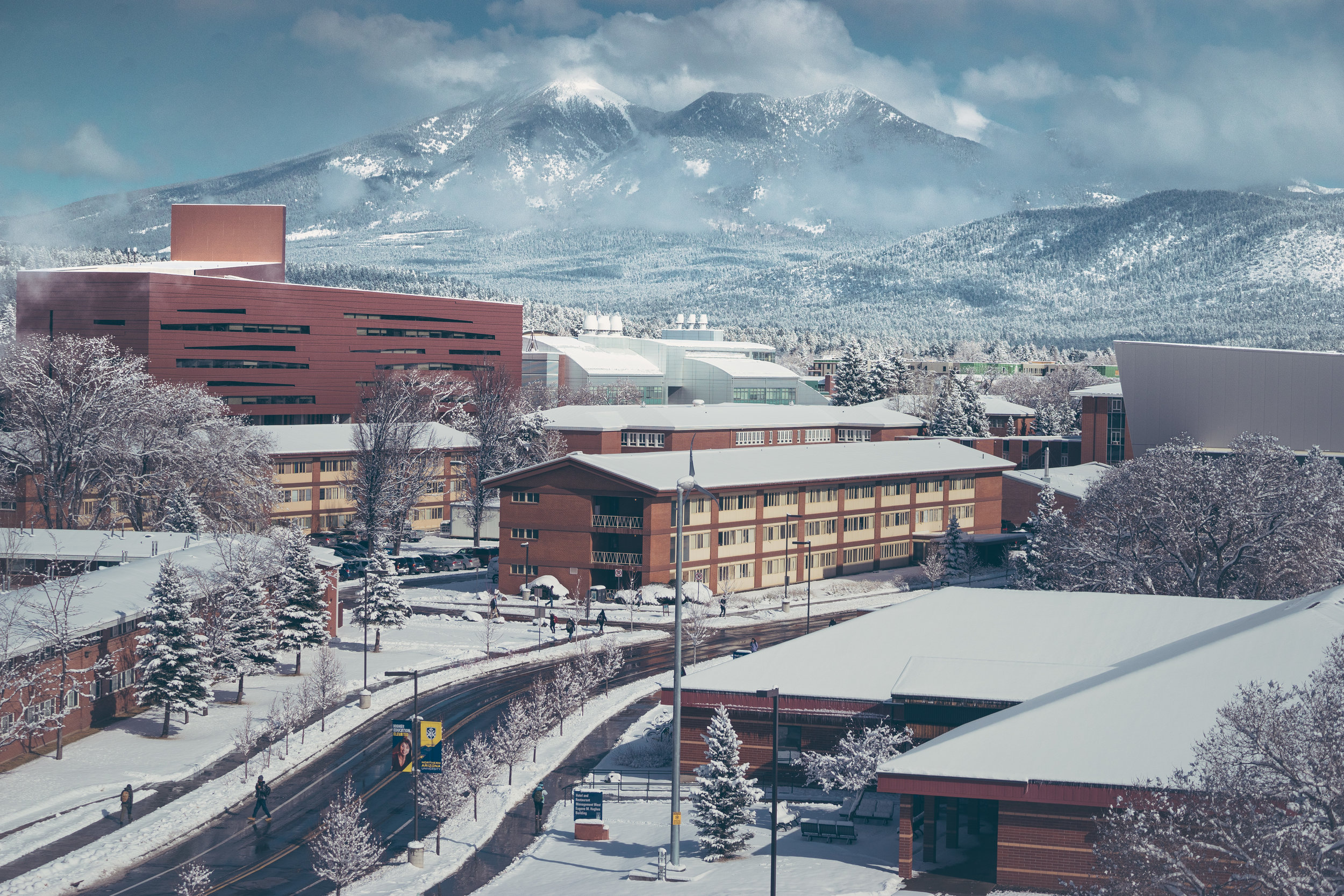Snowy San Francisco Mountain looms large from the Campus of Northern Arizona University