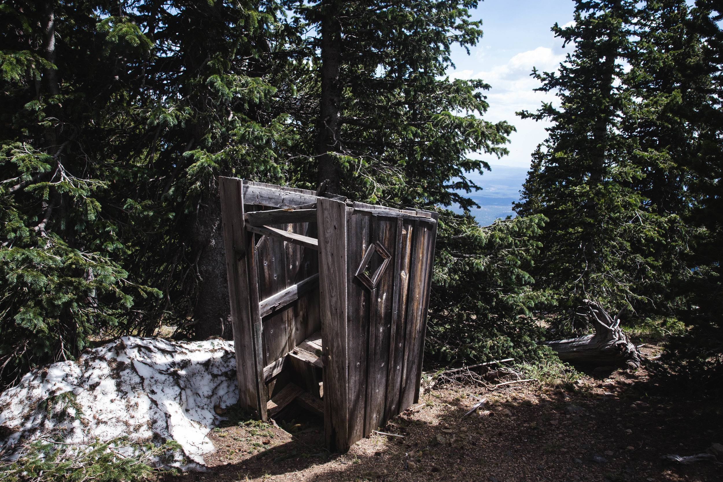 This outhouse is located on the saddle between Abineau and Freemont in the Kachina Peaks wilderness. This outhouse is out of commission, either someone laid one hell of a crap in there or the deep snow forced it off its foundation. In any case, I do not recommend using this guy, but the views were not bad. RATING: ★★☆☆☆