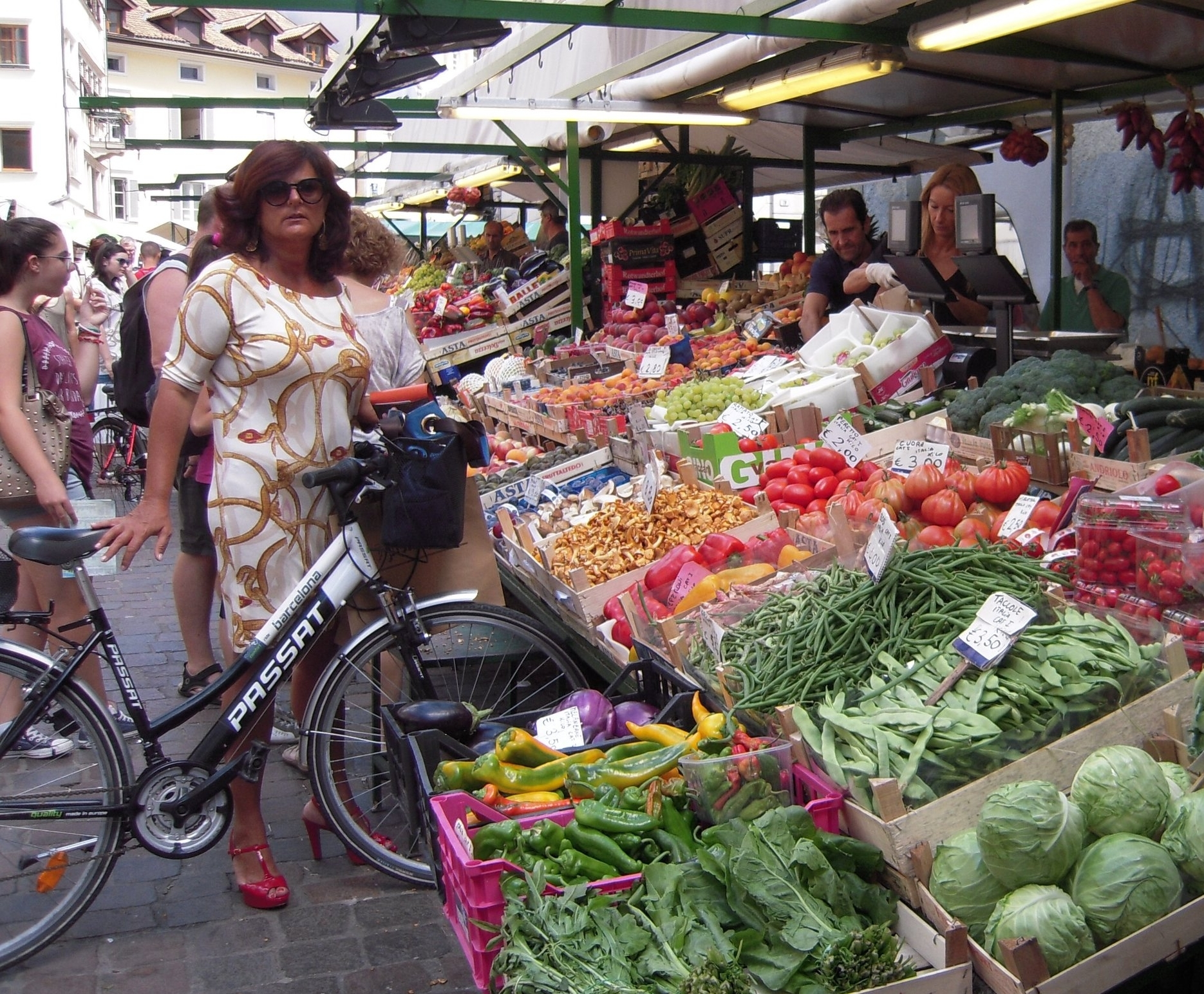 A silk dress and high heels were no deterrent for this woman to ride to market in northern Italy. Photo by Nicole Eikenberry