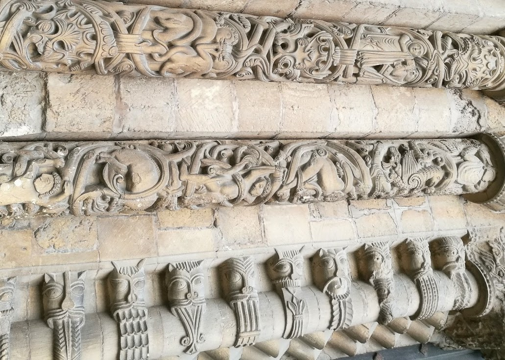 A selection of the intricate Norman carving surrounding one of West Front doors, Lincoln Cathedral (rotated 90 degrees). Those faces! Is it just me or are they somehow hypnotic? Who are they? What are they meant to be?