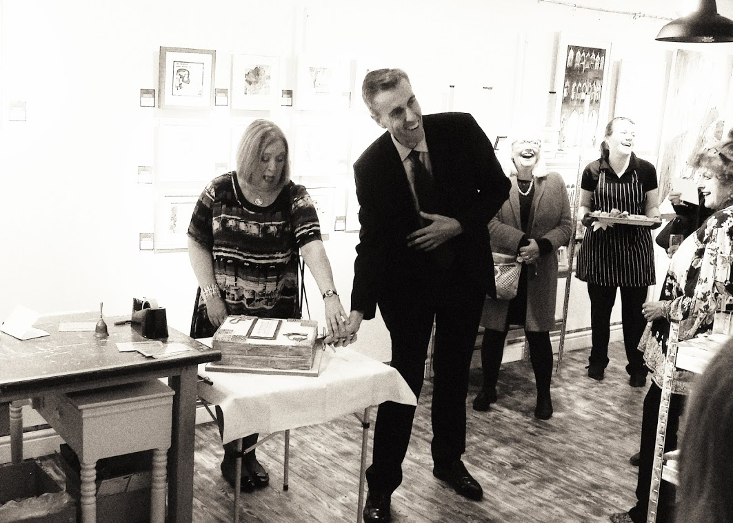 Andrew Selous MP doing the honours with the cake...