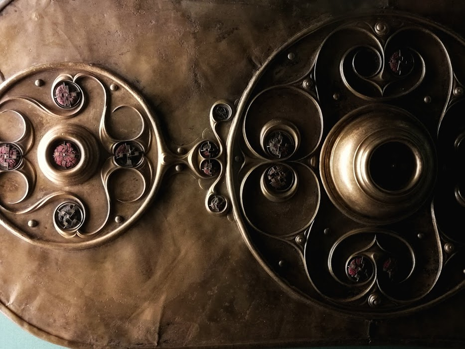 A detail from the Battersea Shield - well over 2000 years old. Made in Britain and recovered from the river Thames. Many similar items have been discovered in rivers, it seems the Celts made offerings to their gods by depositions into water.