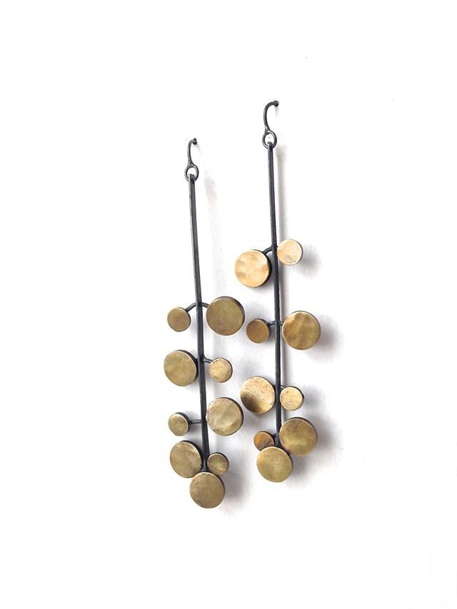 Earrings by Jennifer Bennett/Di Luce Design; deerskin/crystal necklace by Lisa Kinoshita