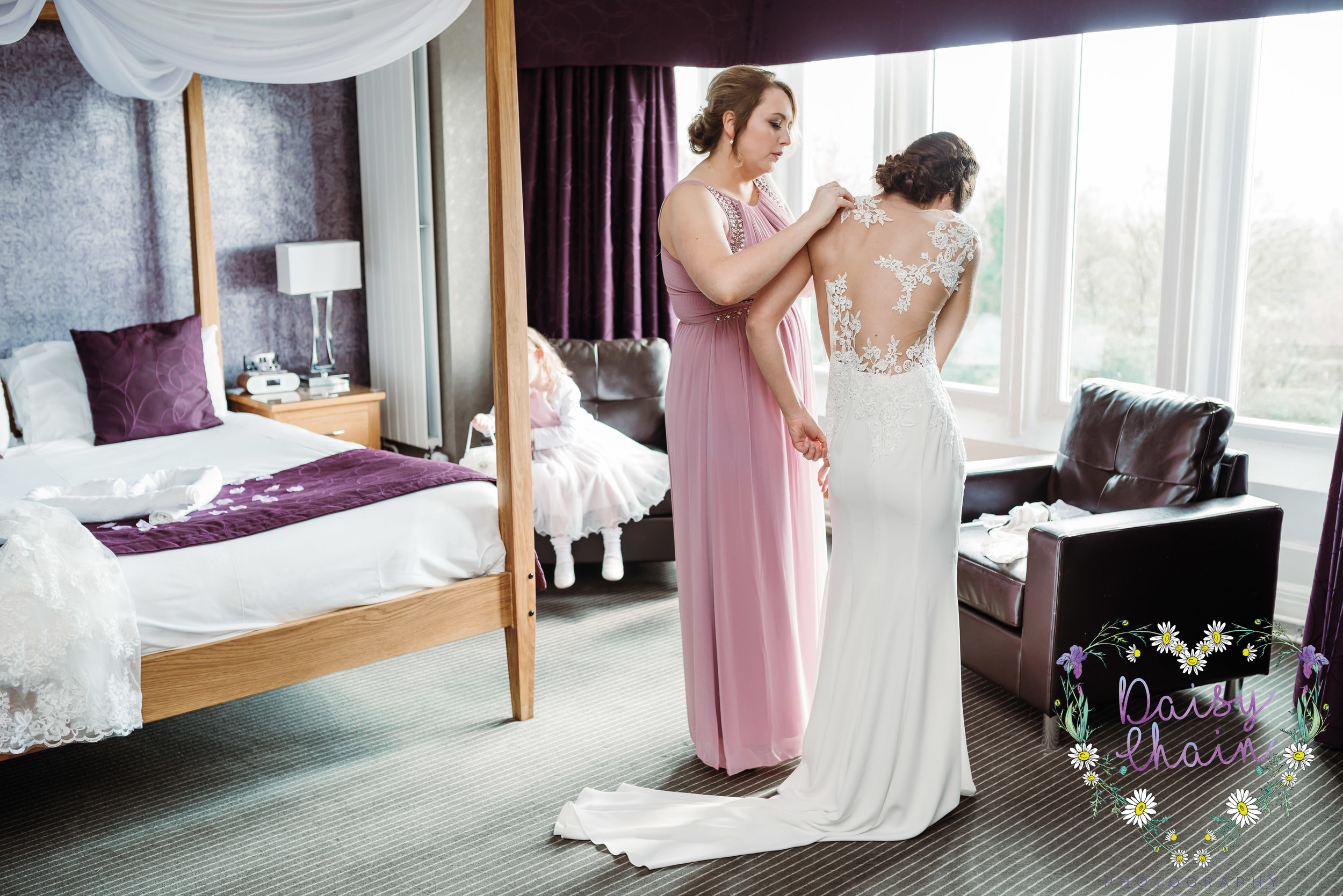 getting the wedding dress on