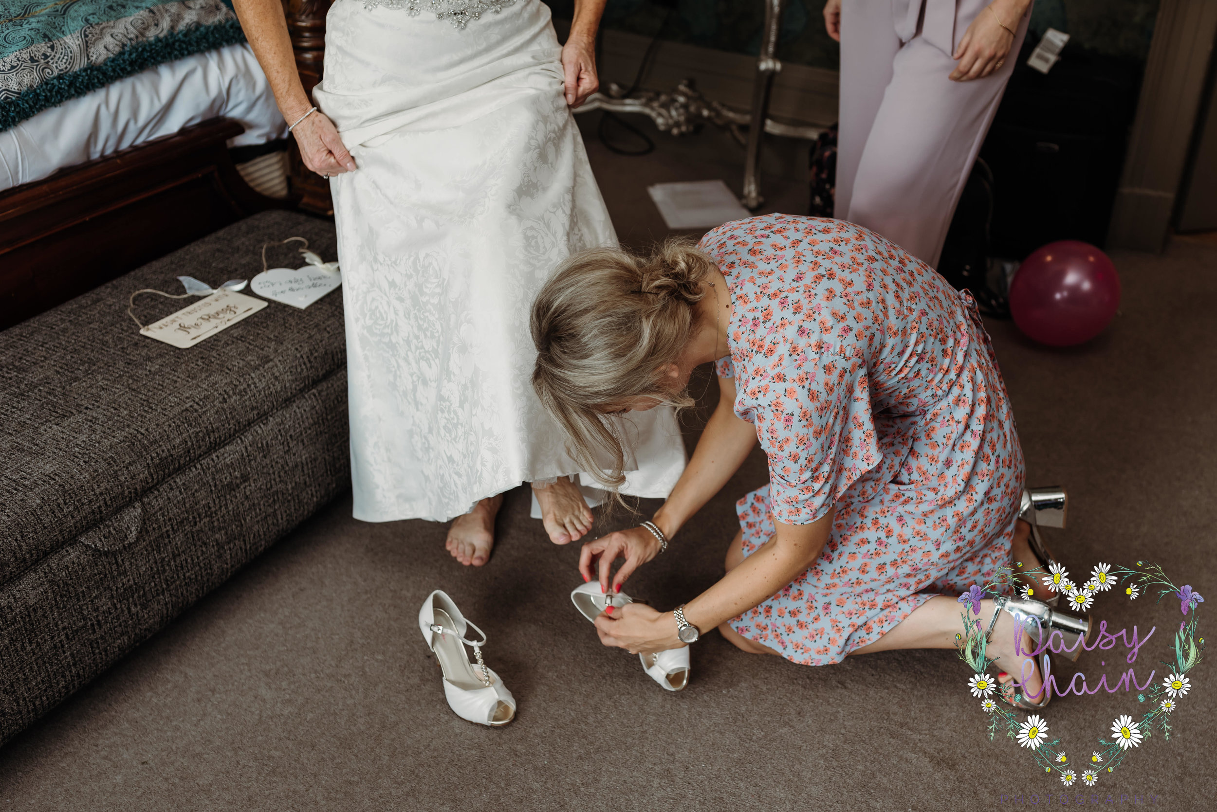 Putting the brides shoes on