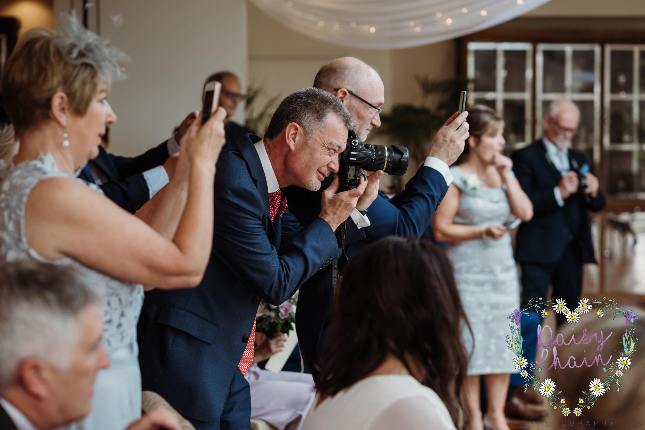 wedding guests with cameras