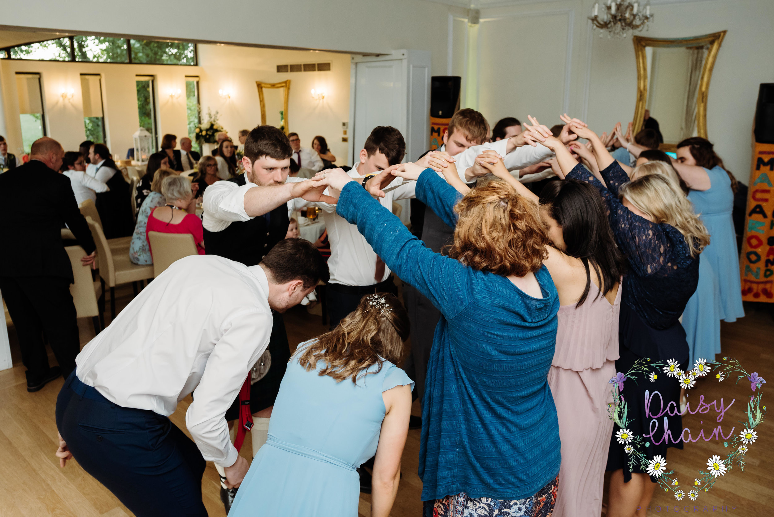 Dancing to a ceilidh band at a wedding