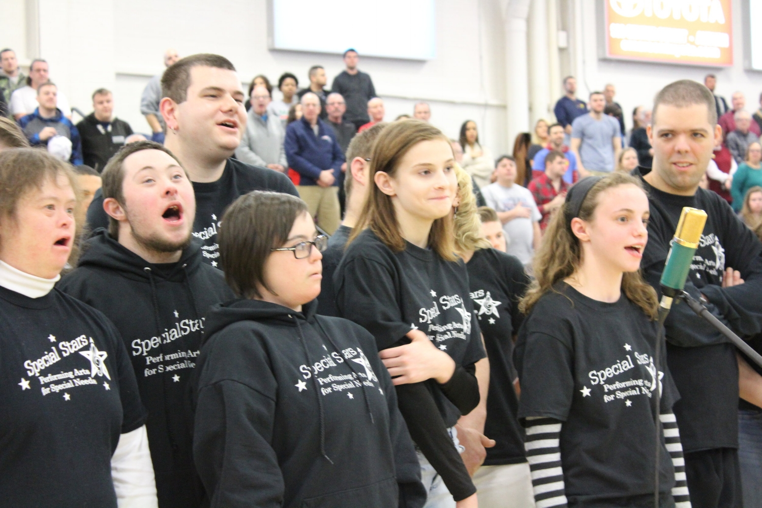 Special Stars students perform the National Anthem at the Maine Red Claws game
