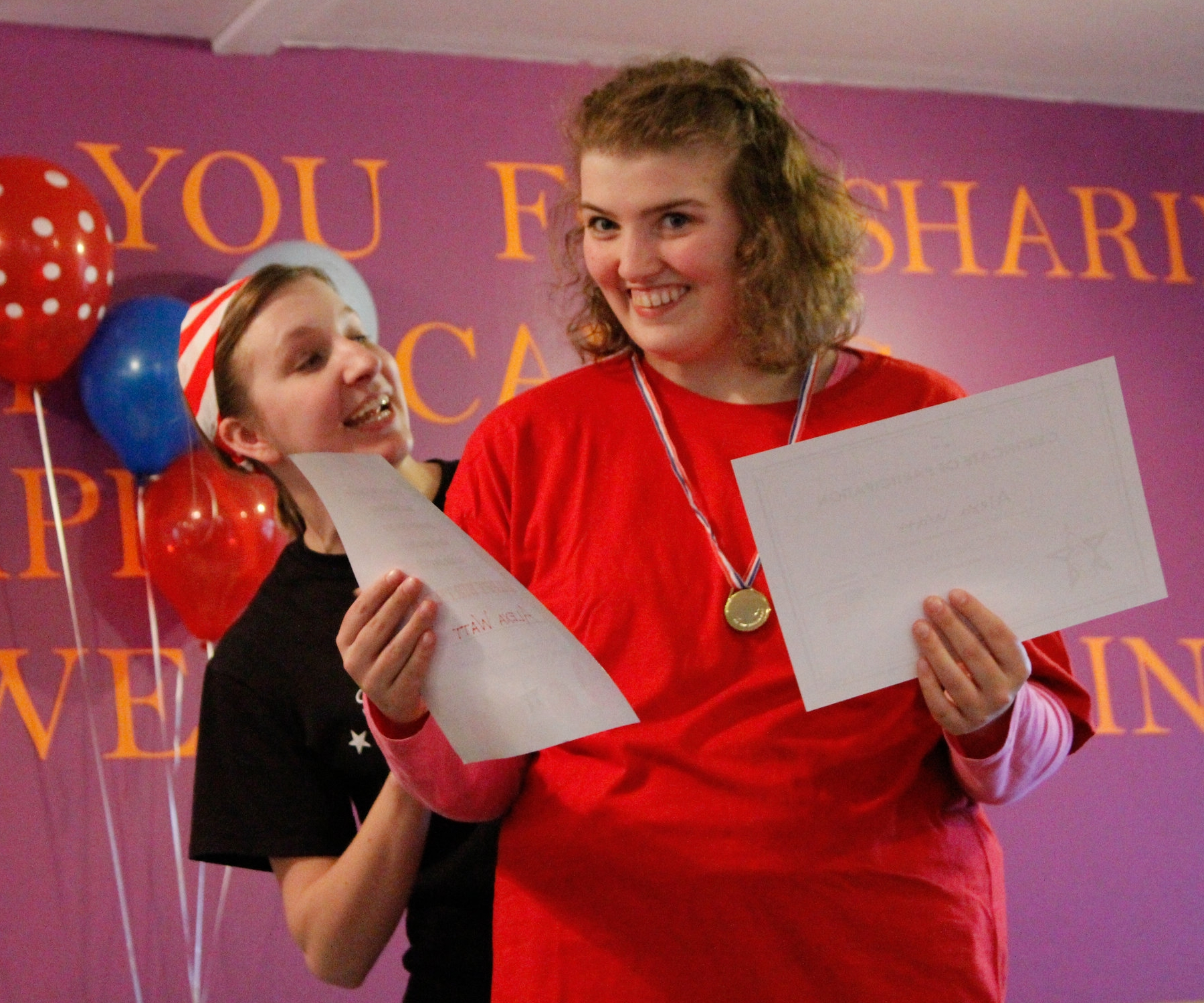 Alexa, a Special Stars Student, receiving her end of session certificate for her hard work!
