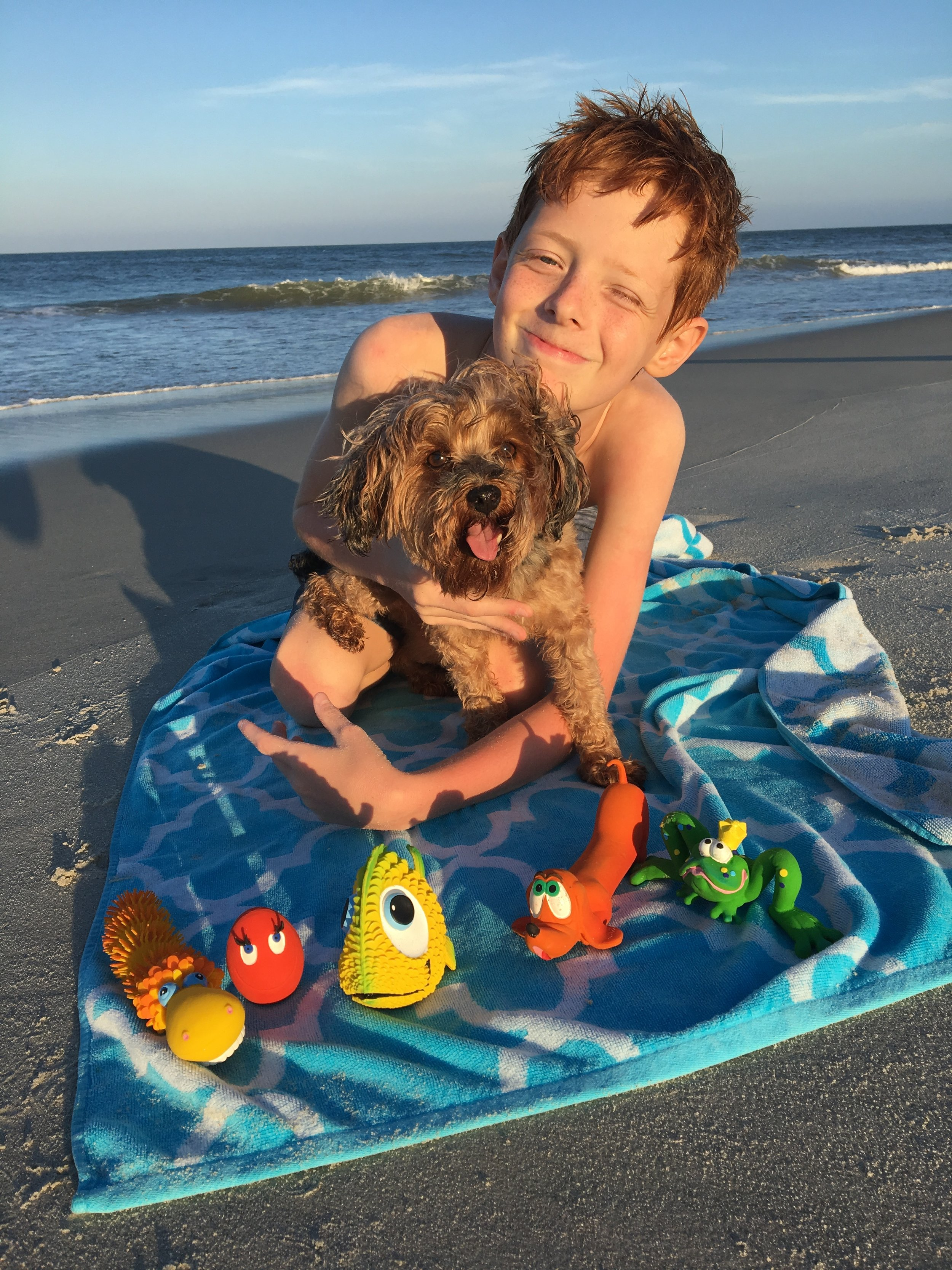 """OUR STORY - My name is Valerie Lecoeur Brockenbrough, and I'm the founder of Lucas b. Natural Dog Toys. I'm also the founder and owner of Zoë b Organic. As an eco-entrepreneur, mom, and dog owner, I'm passionate about offering families safe and healthy choices, including for their dogs. That's why I'm proud to be partnering with Lanco, a family-owned business in Barcelona, Spain, that's been making 100% natural rubber toys for both pets and children since 1952.My husband and I have three great kids, and Lucas b. Natural Dog Toys is named after our 13-year-old son, Lucas (pronounced """"luca""""). Since he was a baby, Lucas has adored dogs of all shapes and sizes. And he's best friends with our Yorkie Poo, """"Rambo."""" (You'll find photos of our scruffy, 7-pound mascot throughout our site.)"""