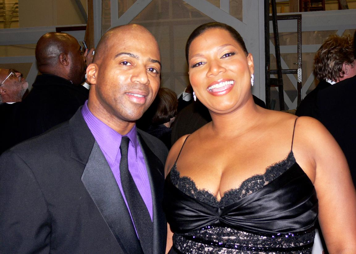 Keith Robinson and Queen Latifah