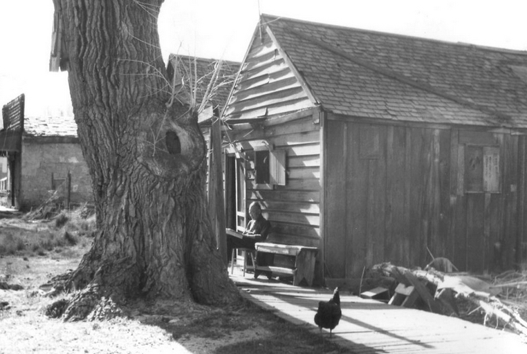 This elderly man reading in front of his house was one of the few remaining residents of Carson City's Chinatown in the mid-1940s. Photograph from the Daun Cohall collection, Nevada State Museum.