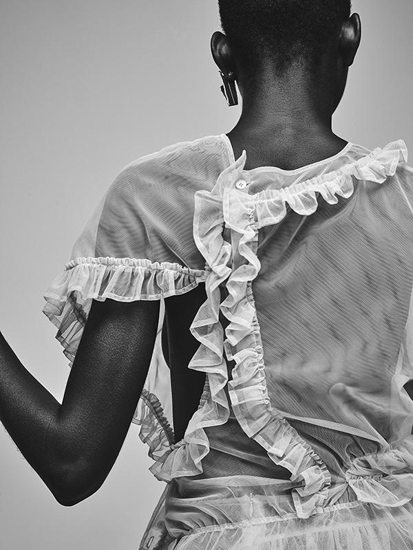 Toulle top by Simone Rocha, gold earring by Zohra Rahman