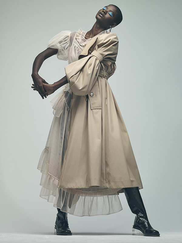 Toulle top, skirt and leather boots all  Simone Rocha , silver earrings and rings  Zohra Rahman