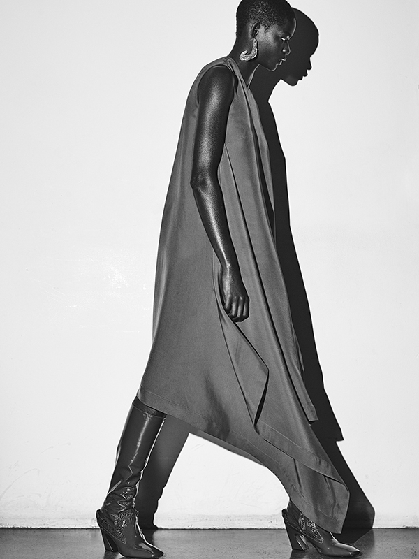 Silk dress and leather boots by Mulberry, silver earring by Cornelia Webb