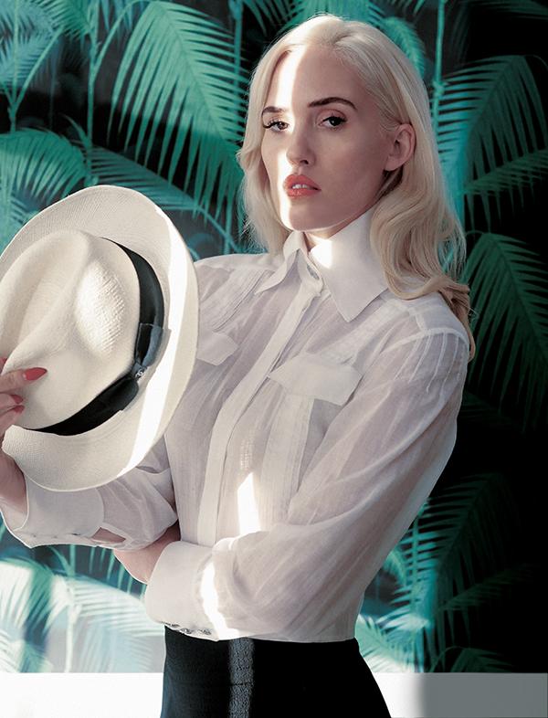 Gauze shirt and Panama hat: Chanel / Black trousers: Rejina Pyo