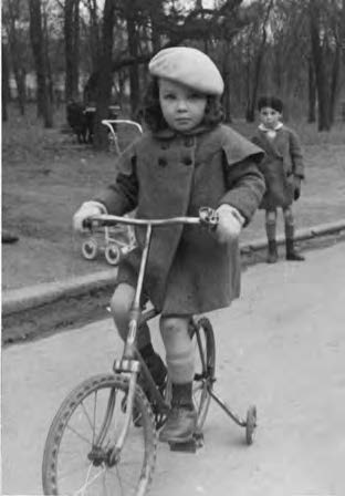 Aged five in the Bois de Boulogne, Paris (her brother in the background)