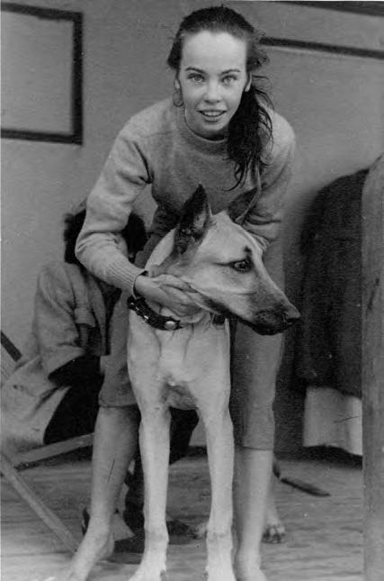 Aged 18 with a friend's dog in California, whilst filming An American in Paris