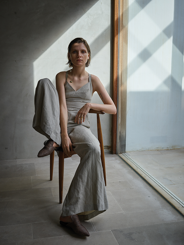 Top and skirt:  Vivienne Westwood , Sandals:  Joseph, Ring:  Alighieri , Earring:  Dinosaur Designs