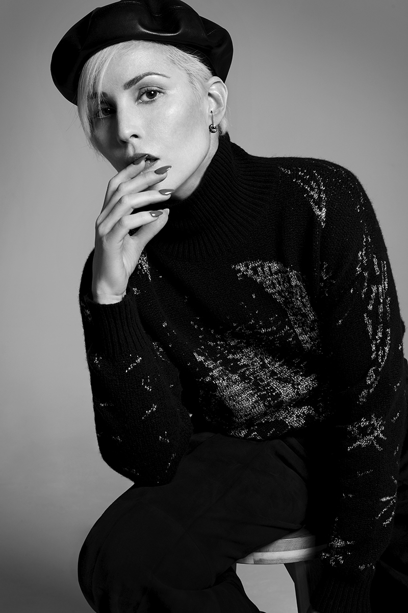 Black beret, jumper and trousers:  Dior /  Earring:  Ara Vartanian