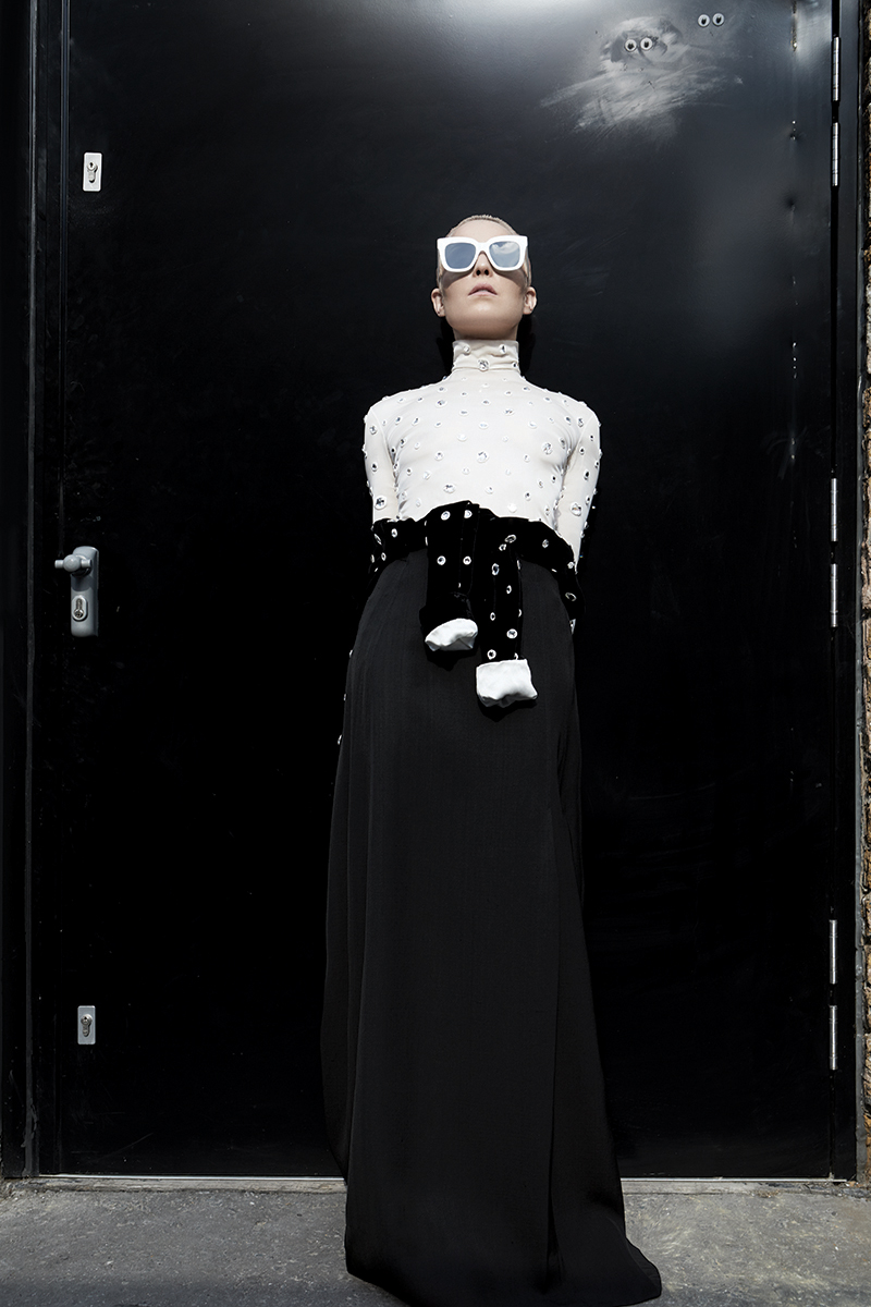 Top, top around waist, skirt and sunglasses:  Céline
