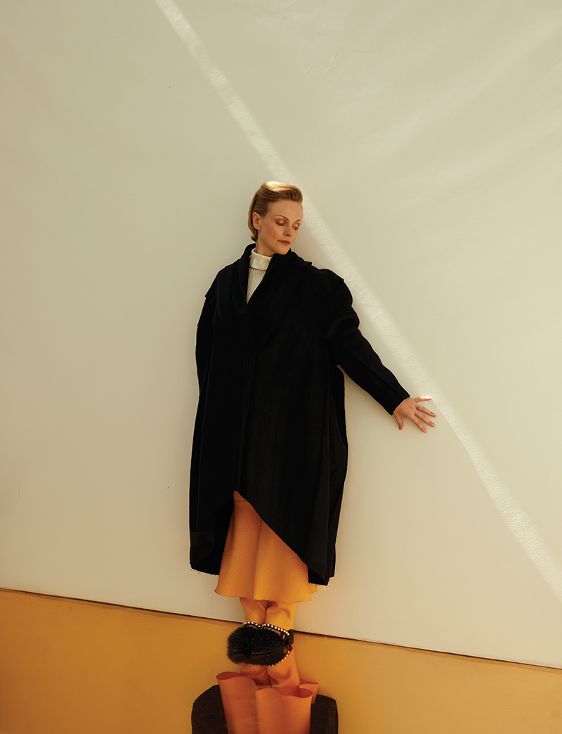 Coat:  Chalayan /  Jumper:  Xiao Li /  Trousers:  Edeline Lee /  Shoes:  Mother of Pearl