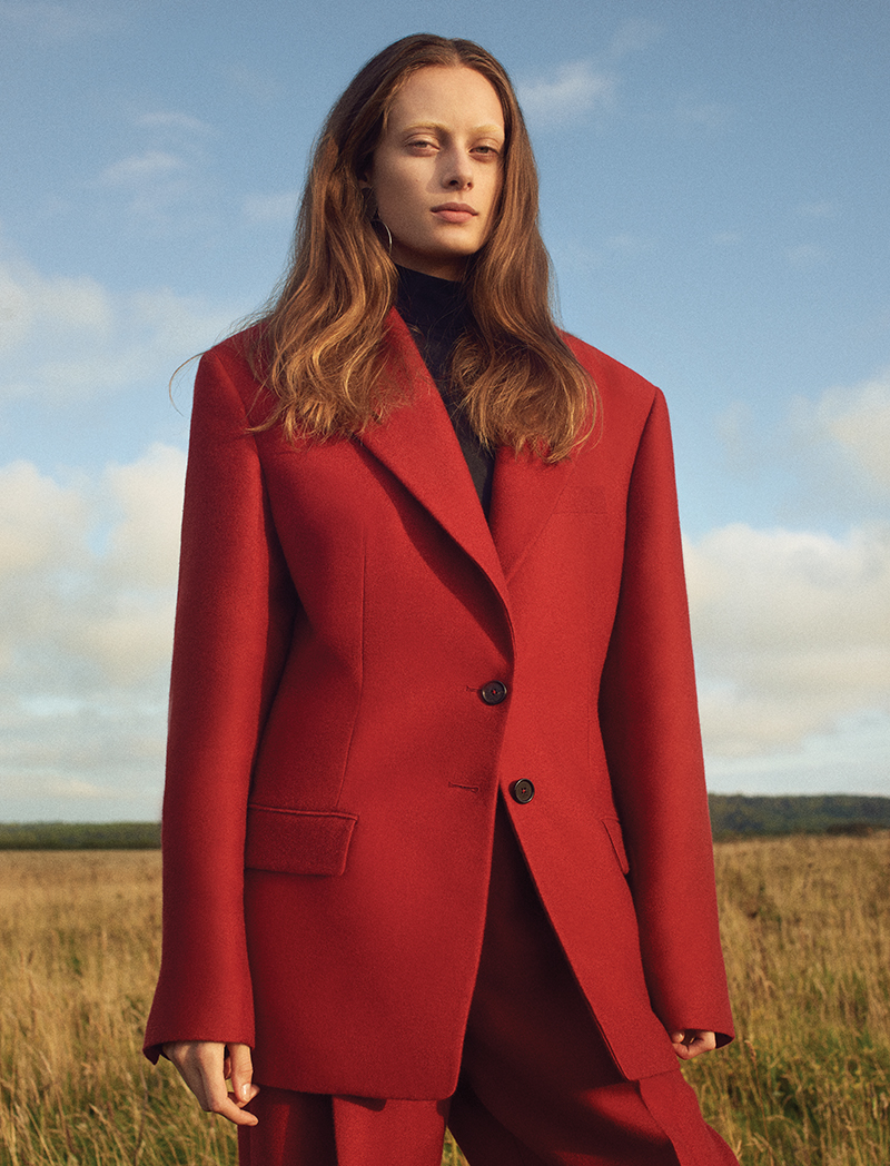 Jacket, trousers and high neck blouse:  Jil Sander  / Earrings:  Annie Costello Brown