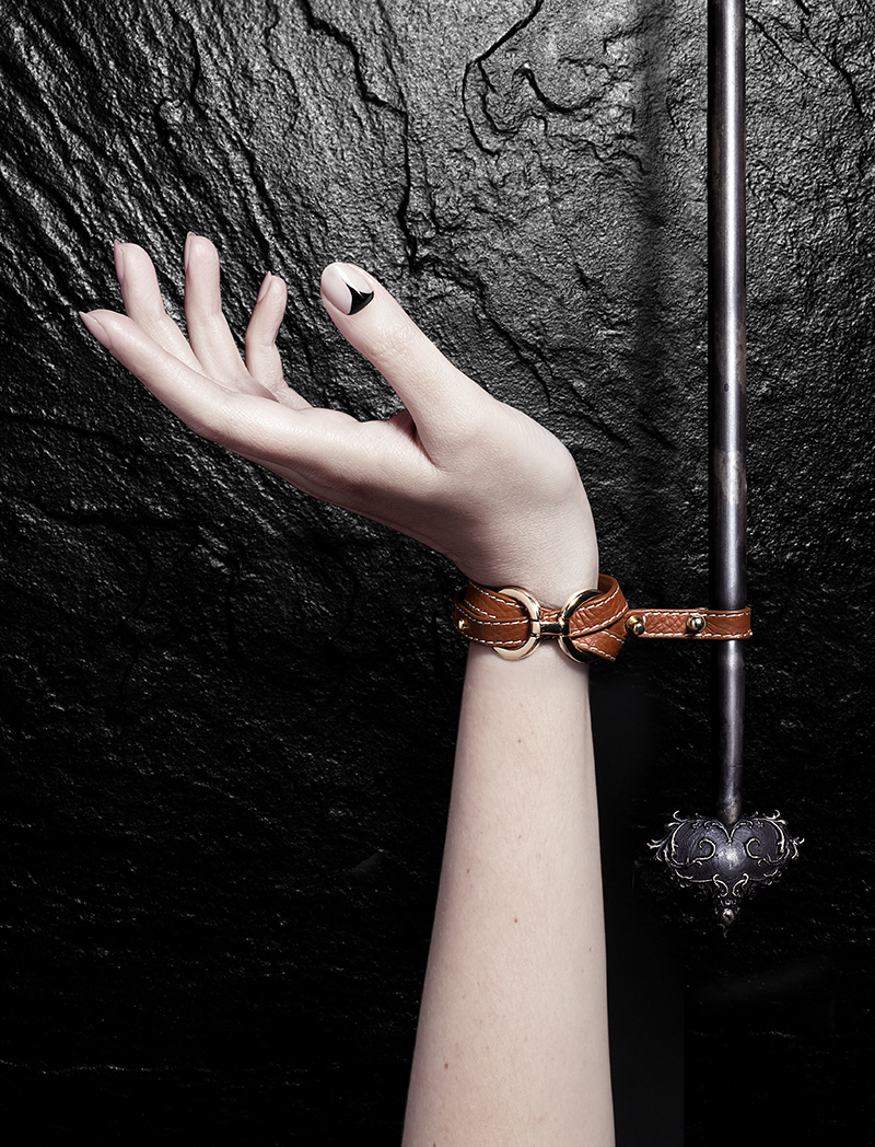 Teresa  short arrow wrist restraint in brass/bronze patina with leather/gold plate cuffs. Price: £1325