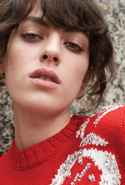 Embroidered jumper:  Miu Miu  / Earring:  By Pariah