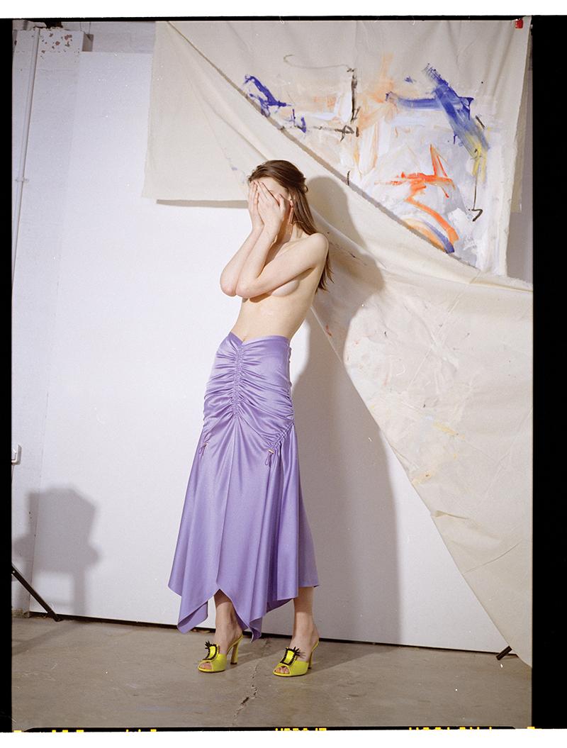 Skirt: Tibi / Shoes:  Manolo Blahnik / Earrings:  Theresa Marx