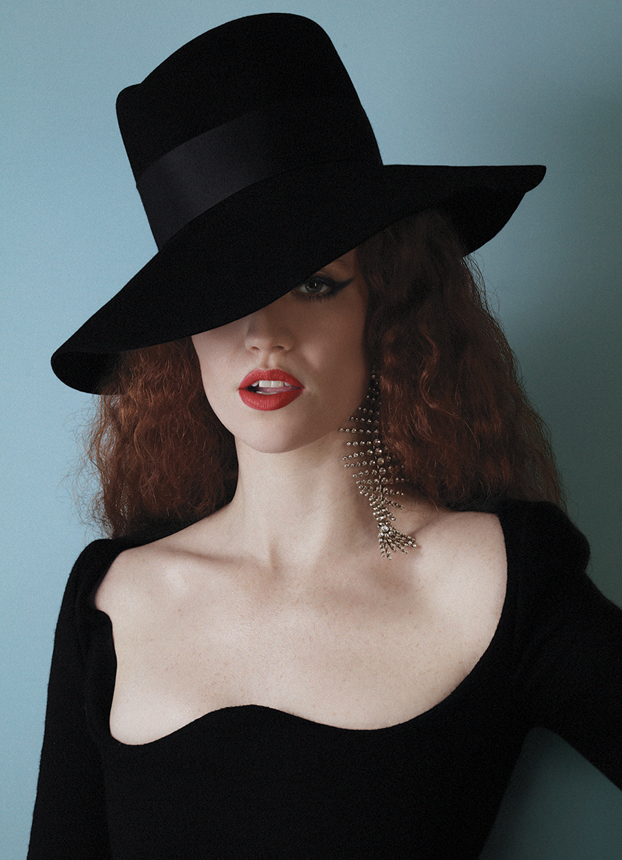 Black gown, hat and earring:  Saint Laurent by Anthony Vaccarello