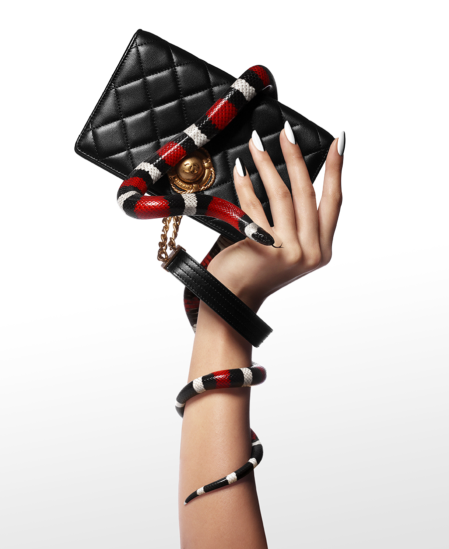 Black lambskin clutch with wrist strap, £2,610:  Chanel