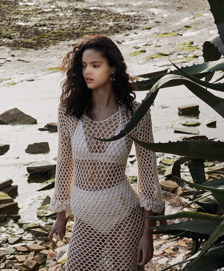 Bikini top:  Solid & Striped /  Knitted pants and knitted cream dress:  Ayni /  Earrings, long gold chain necklace and pendant:  Bjørg